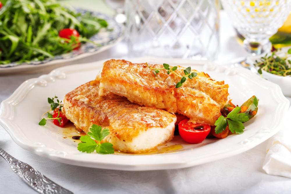 Fried Alaskan pollock in a dish